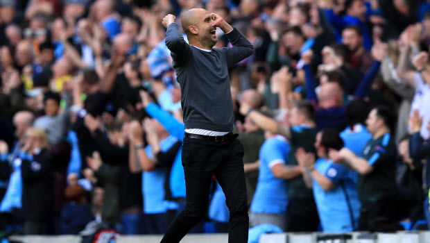 Manchester-City-manager-Pep-Guardiola-celebrates-a-goal-during-the-Premier-League-match-at-Etihad
